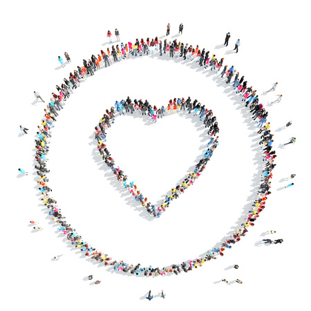 A large group of people in the shape of a heart.