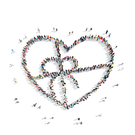 listening to heartbeat: A group of people in the shape of heart, cardio, flash mob. Stock Photo