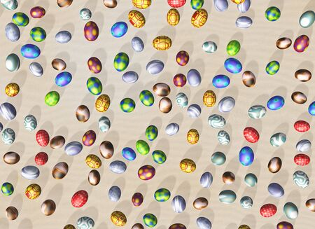 Easter eggs with different colors seen from above lying on a bed of sand at random Stock Photo