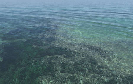 Sea with crystal clear water with a vision of rocks on the seabed Stock Photo