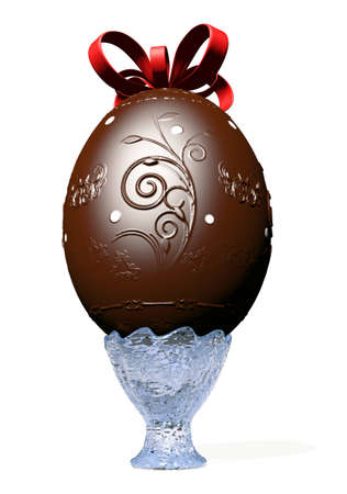 Big decorated chocolate easter egg on glass vase with a red ribbon on his head