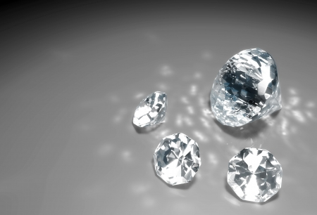 a closeup of a group of three small diamonds and a bigger one are lying down on a grey surface with some reflections of light around them Stock Photo - 18373406