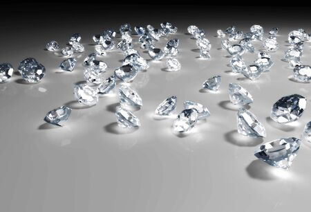 some diamonds of different size and in a random disposition are lying on a grey floor, with a light over them that fades to dark in the distance Stock Photo - 18373431