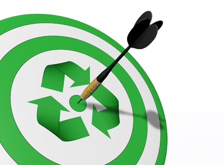 a closeup of a target with a green recycle symbol in the center and a perfect shot of a dart in the middle of it