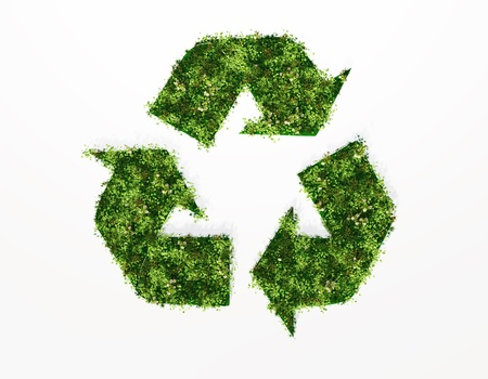 a top view of a recycling symbol covered by grass and flowers, on a white background