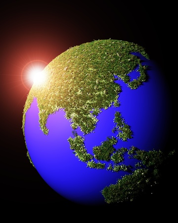 a 3d rendering of a sunset behind the world that has the Asia continent made by grass and flowers, on a black background Stock Photo - 19667496