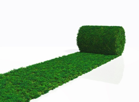a roll of grass carpet is unrolling in one direction on a white background Stock Photo