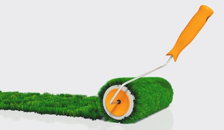 a closeup of a paint roller with an orange handle, that is painting a grassy strip on a white ground using lawn as colour