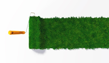 a top view of a paint roller with an orange handle, that is painting a grassy strip on a white ground using lawn as colour