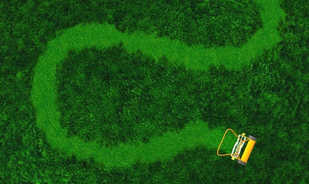 a top view of lawn where there is an orange push lawn mower in movement that is cutting the grass drawing a curved path on the grass