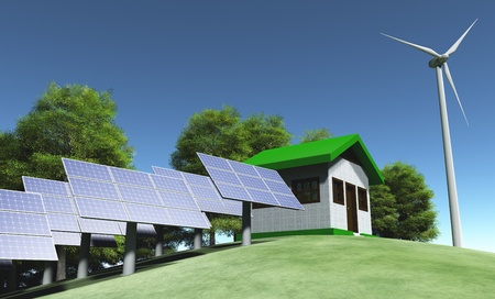 view of a small house placed on top of a grassy hill that has some solar panels on its right, a wind generator on its left and some trees behind them photo