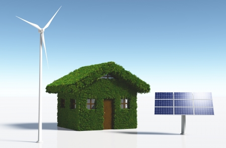 a small house covered by grass on the walls and on the roof, has solar panels placed on one side and a white wind generator on the other side, on a white background and a blue sky photo