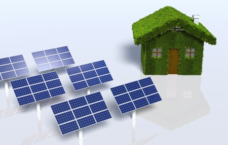 a small house covered by grass on the walls and on the roof, has on the left some solar panels placed on the ground, on a white background photo