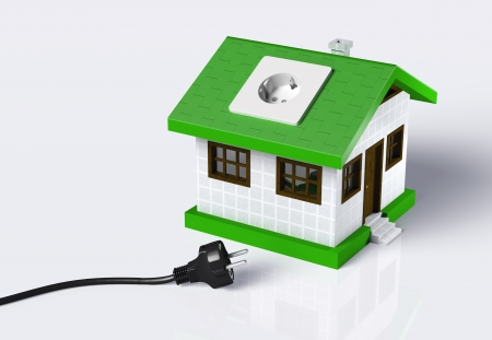 grounded plug: a small house with a socket on the roof is disconnected from a black cabled plug that lies on the ground  On a white background
