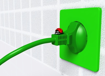 a small ladybug is on an ecological green plug that is connected to a green socket placed on the wall photo