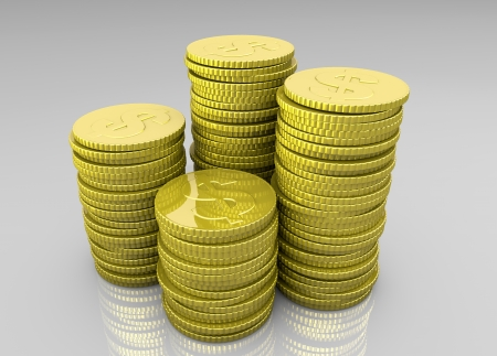 a closeup of four stacks of shiny golden coins with different heights and a symbol of the dollar on each coin Stock Photo