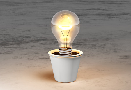 a light bulb with warm light is planted in a white vase and lies on a white and grey abstract ground