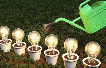 some lit light bulbs in white pots arranged in a row are watered by a green watering can, on a grassy ground
