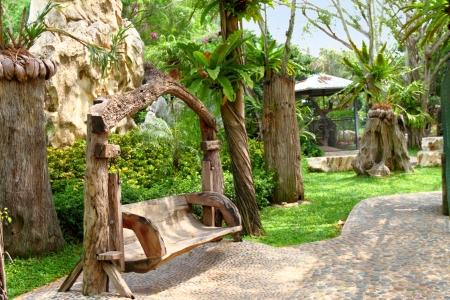 Wooden bench in the Million Years Stone Park. Pattaya. Thailand