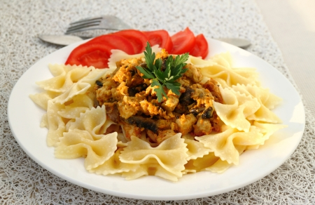 Farfalle with chicken fillet and mushrooms stew