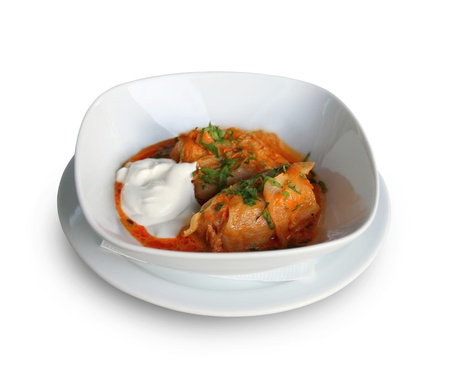 Stuffed cabbage with tomato sauce in white plate Stock Photo