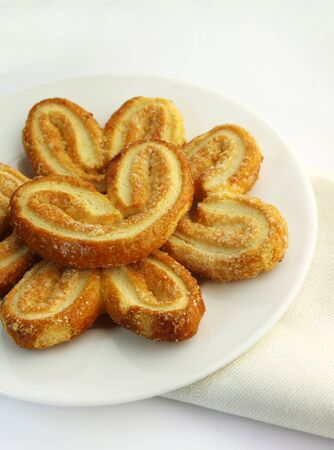 Puff pastry. Sweet palmier cookies on a plate Stock Photo