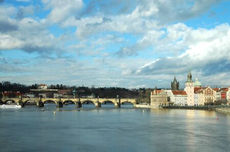 Prague. Charles bridge and spires of the old town  photo