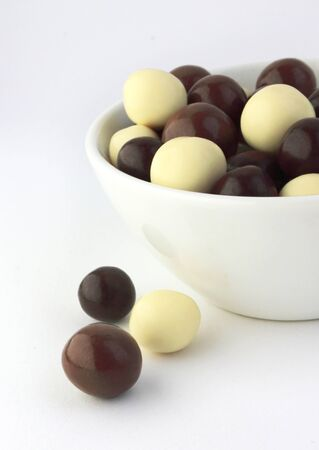 dragee: Assorted chocolate dragee in a bowl