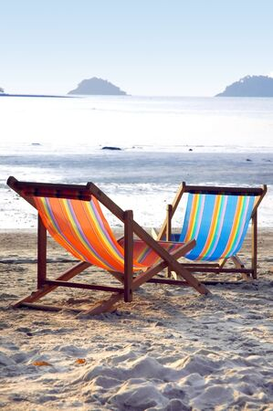 sunbeds: Two sunbeds on the beach in the evening sun