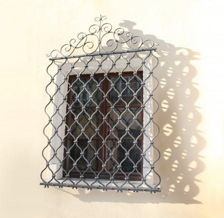 lattice window: Decorative window grid dropping openwork shadow Stock Photo