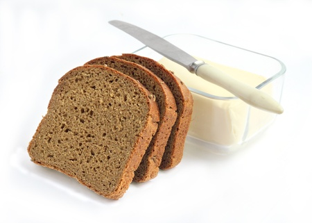 Slices of rye bread and butter in a glass container