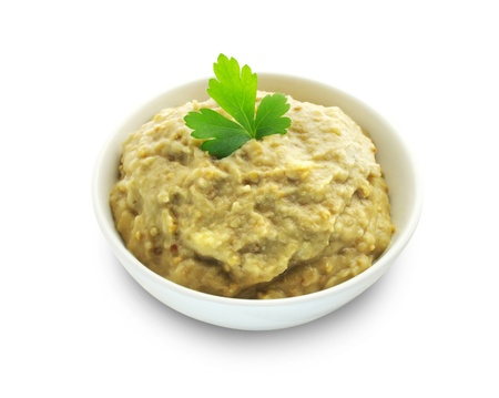 Aubergine paste in a bowl on white background Stock Photo