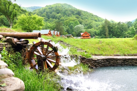 Stream with wooden water wheel in the Carpathians