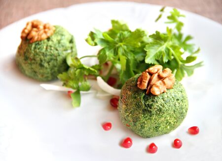 Pkhali - balls from the leaves of beets, spinach, and walnuts Stock Photo