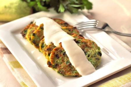 Zucchini pancakes with green onions and sour cream