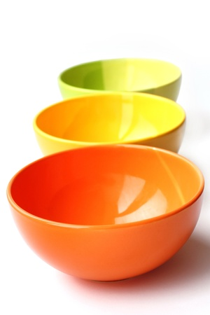 Three colored bowls on white background photo