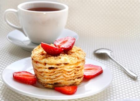 Piece of Napoleon cake with fresh strawberry Stock Photo