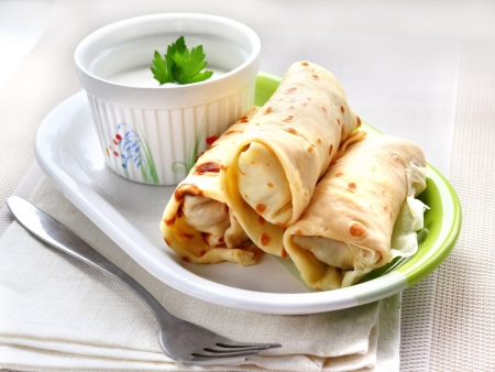 Crepes stuffed with meat and vegetables Stock Photo