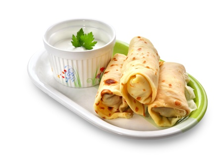Crepes stuffed with meat and vegetables isolated on white background photo