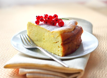 Cheesecake decorated with red currant photo