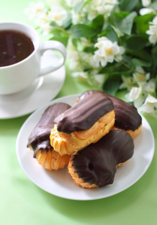Eclairs with cream in chocolate coating photo