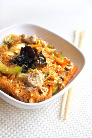 Spicy glass noodles with beef, vegetables and eggs photo