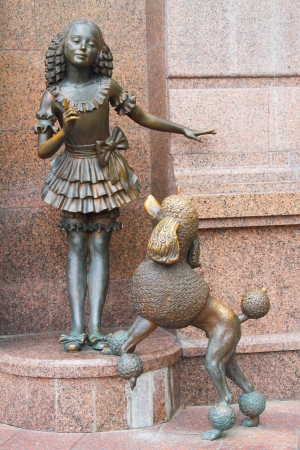 Malvina and dog Artemon  Bronze statues of characters from fairy tale by Alexei Tolstoy,  The Golden Key, or the Adventures of Pinocchio  photo