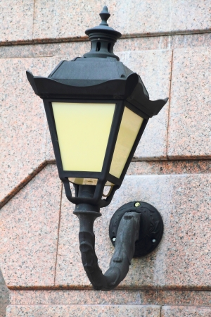Street lamp attached to the wall of the building