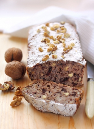 Banana cake with walnuts and dark chocolate photo
