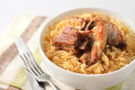 Pork ribs baked with sauerkraut Stock Photo