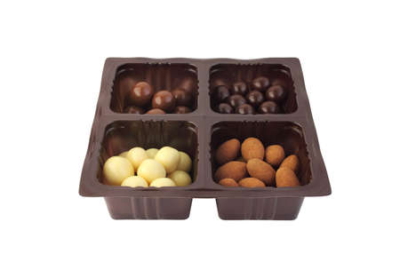 Assorted candies in plastic container photo