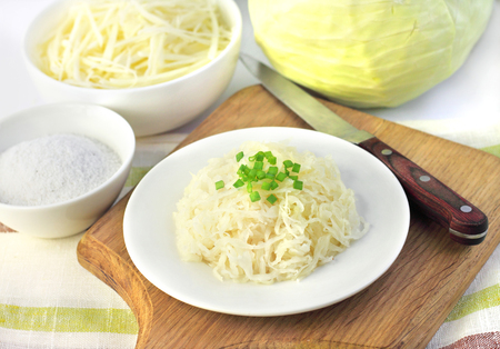 Sauerkraut and ingredients for making it photo
