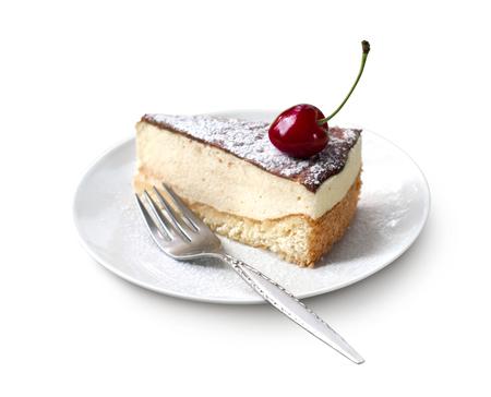 Milk souffle (bird's milk) cake with fresh cherry isolated on white