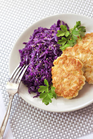 fritters: Chicken fritters and stewed red cabbage with caraway seeds